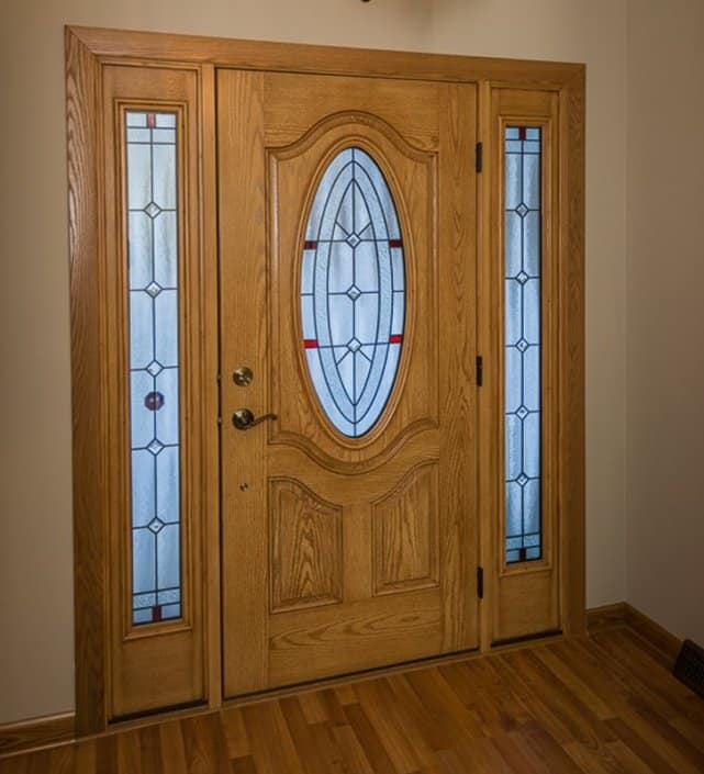 Entry Door with two sidelites & oval leaded glass & natural oak interior stain in Franklin, WI